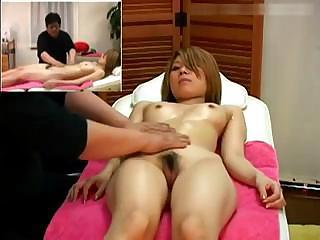 Oiled-up Asian babe undergoes thorough massaging procedure
