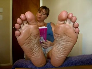 Bare soles in your face
