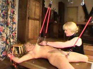 Female dominatrix tortures her tits and gives her a double fisting