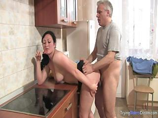 Mature Couple Prepare Dinner In The Kitchen