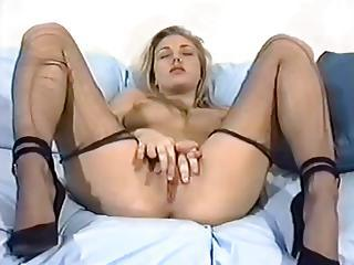 Solo Hottie In Ripped Hose Masturbates