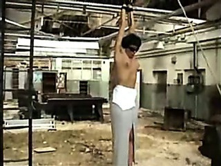 Arms Suspended  From Ceiling And Flogging