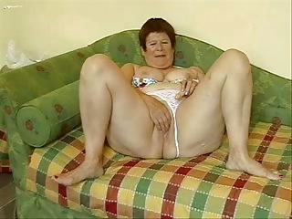 Busty Granny Masturbates In Front Of Cam