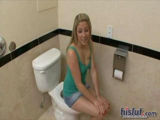 Malia Sits On The Toilet