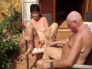 Horny old lady naked outdoors with hubby