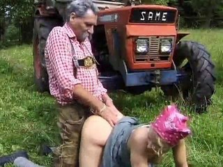 Old Tractor Man and His Cute Milkmaid