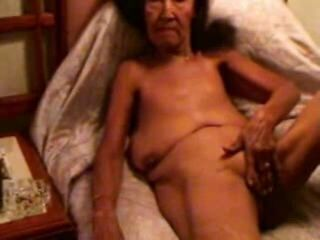 Very old whore smoking and ma...