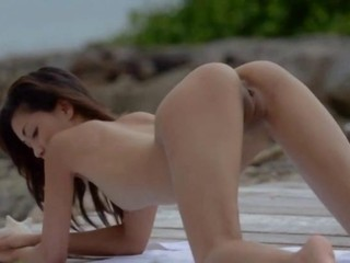Exotic babe masturbating on the...