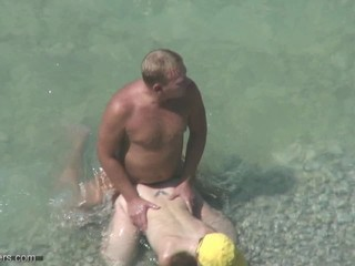 couple at one's fingertips the beach cought by hidden cam