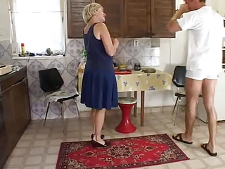 Mature Lady And Younger Man In The Kitchen