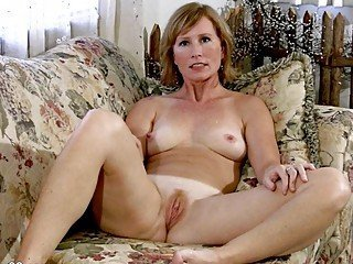 Big titted MILF babe fingers her wet pussy