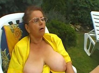 Redhead granny sucks a big cock in the shared