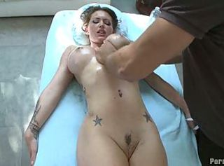 Busty dame gets a oiled pussy massage