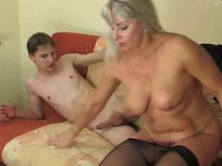 Young man enjoying a randy older woman
