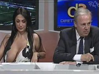 Huge tits girl on Italian news program