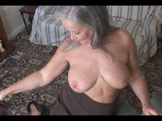 Attractive busty granny striptease