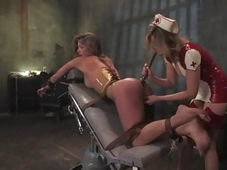 Nurse wearing bondage screws her patient up her tight ass using a fuck pole.