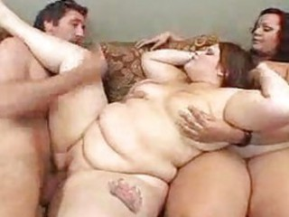 Two huge women share in his big cock