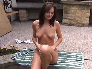 Horny Brunette Babe Gets Naked And Masturbates Outdoors