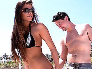 Madelyn is hot, in more ways than one. She is tan, has a great set of tits, nice ass and she wants some cock. She's in from L.A. and hanging out on the beach where she meets up with Shane.