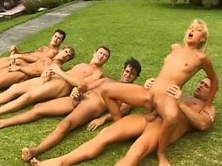 Blonde Teen Has A Mean Gangbang Outdoors