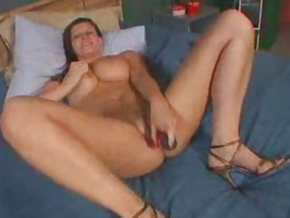 Chubby girl with a dildo fucks her cunt