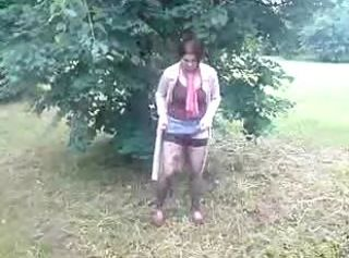 Depraved brunette milf in stockings pissing like a man outdoor