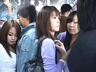 Japanese AV Model gives a handjob to a horny guy in a public motor coach