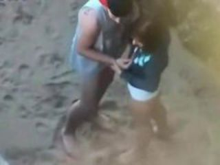 Girl pleases boyfriend on beach