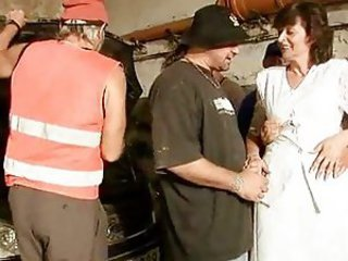 Horny mature does a gangbang in garage