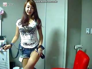 Asian girl is on her webcam e...