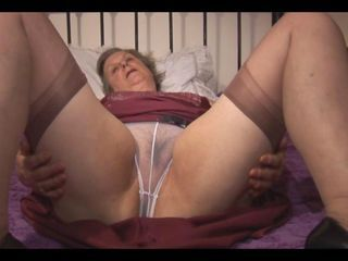 Granny in slip stockings and ...