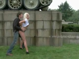 Blonde prostitute with large breasts getting a blowjob outdoors and...