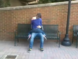 Students humping on a bench in...