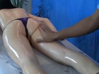 Sexy brunette enjoys oil massage