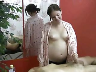 Pregnant Girl Gives A Handjob