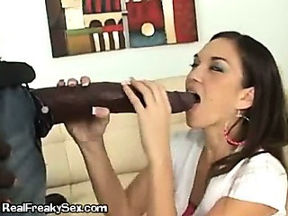 A Young Brunette Playing With A Gigantic Cock