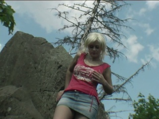 Busty Teen Plays With Her Pussy On Some Rocks!