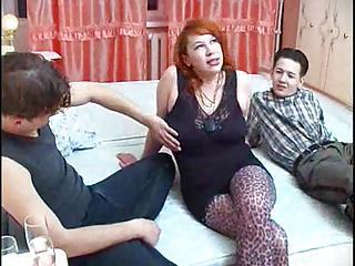 Fat Redhead Is Fucked By Two Horny Guys