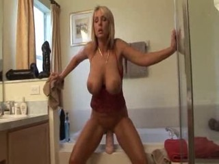 Milf plays with toys in bathroom