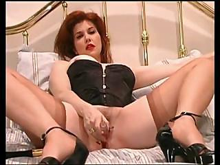 Sexy Milf Wide A Corset Uses A Dildo And Masturbates On Webcam