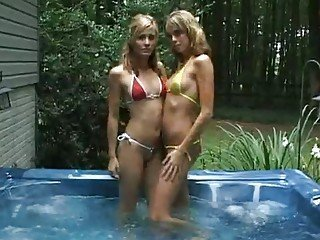 Lovely blonde dykes making out in the pool