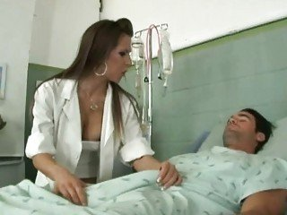 Alluring young nurse riding on top of her patient's huge johnson