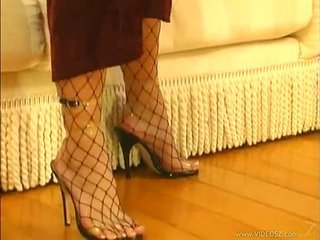 Fishnet pantyhose are amazing atop this slut