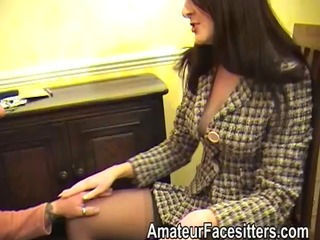 Posh Serrate facesits an eager guy in her business suit