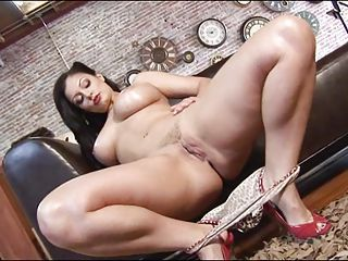 Busty hot babe Aria Giovanni spreads her freshly shaved clamburger on the couch