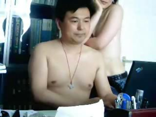 Amateur Oriental couple set up the webcam and fuck at the desk