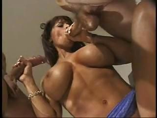 Muscle Mommy Enjoying 2 Dongs