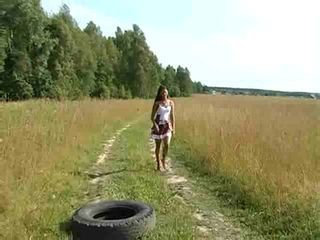 A Curious Slim Girl Walks i...