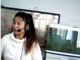 Chinese MILF shows breast and...